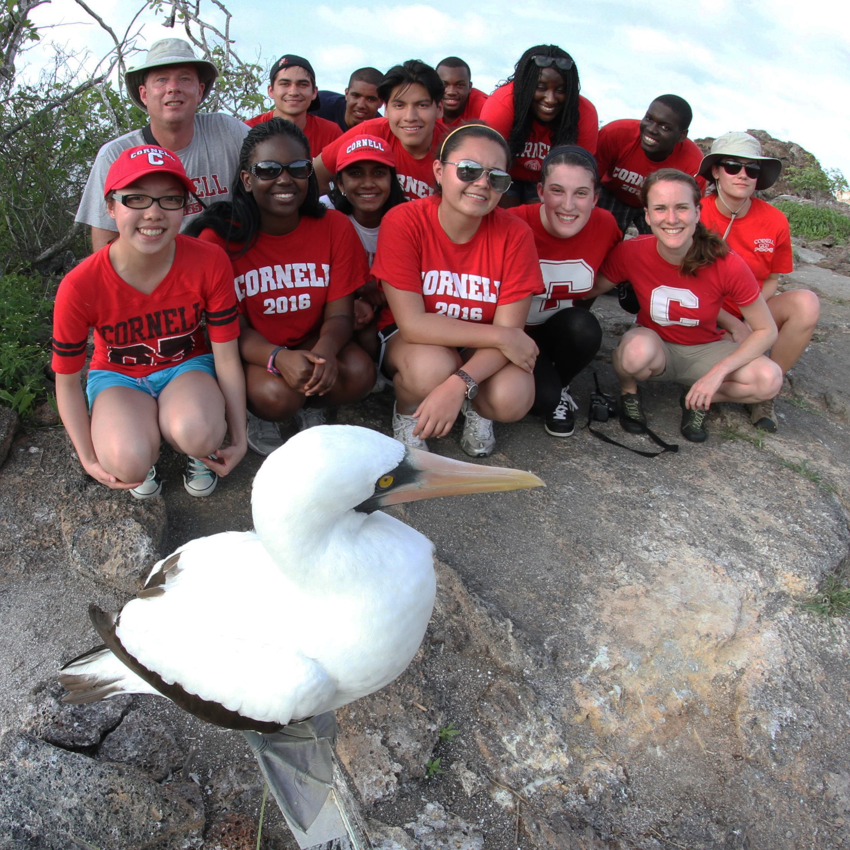 Galapagos field course group with bird from Irby Lovette