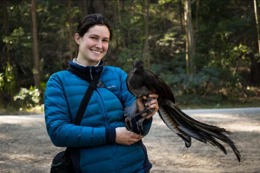 Undergraduate student, Kelsie Lopez shown holding a lyrebird
