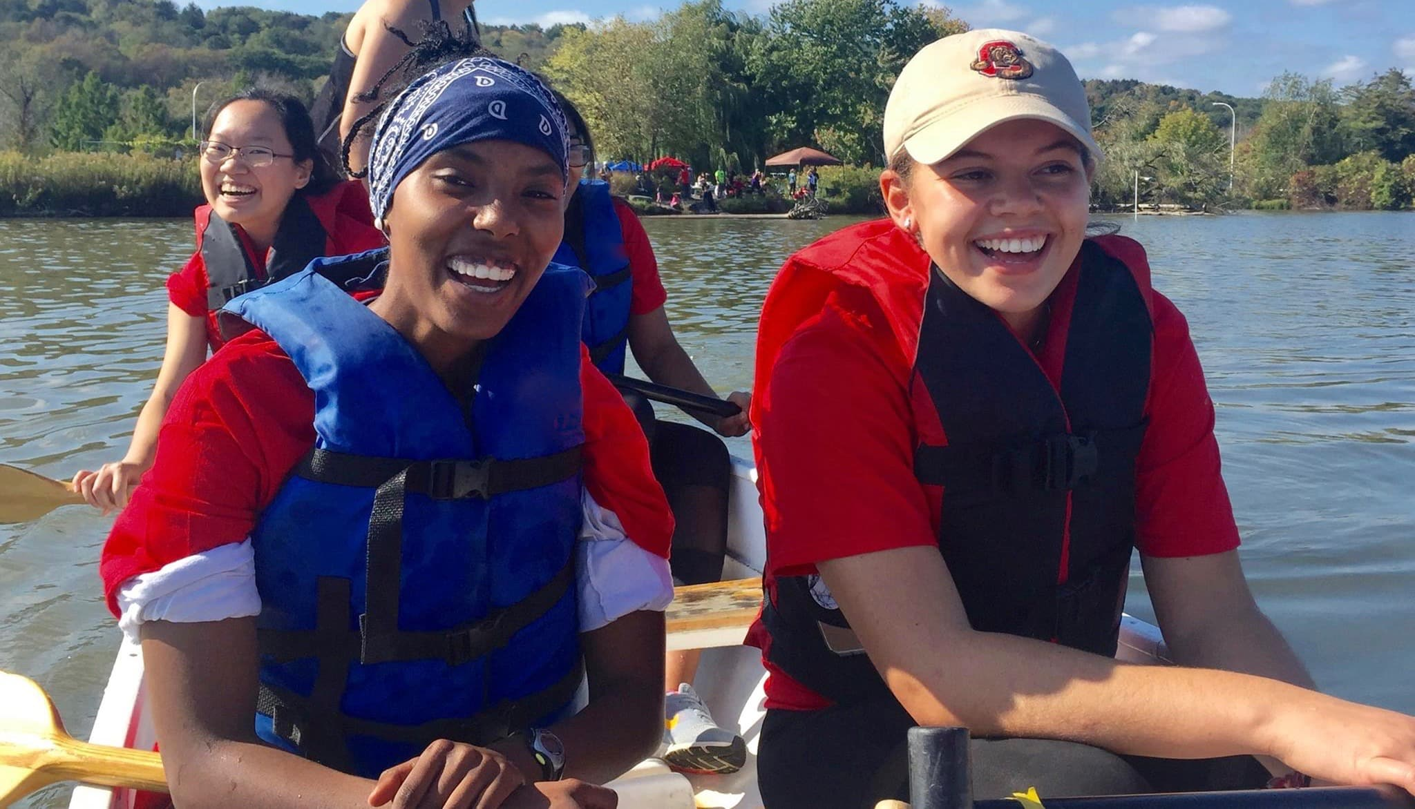 Biology students on a field trip aboard a canoe on Beebe Lake at Cornell