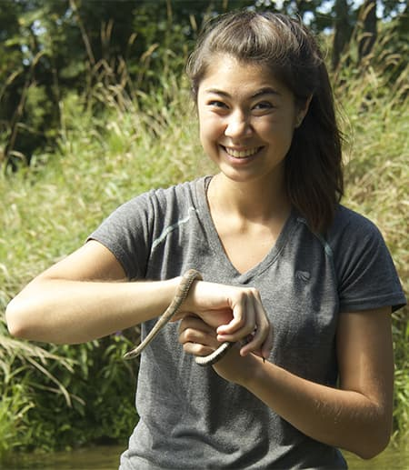 EEB undergraduate student with a snake collected during a class field trip